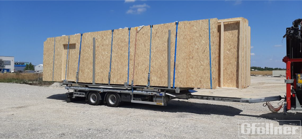 Tandem plateau trailer with extendable pull rod